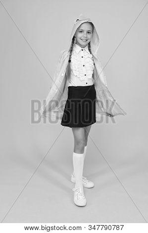Schoolgirl Hooded Raincoat Going To School. Waterproof Clothes. Kid Girl Happy Wear Raincoat. Rain I