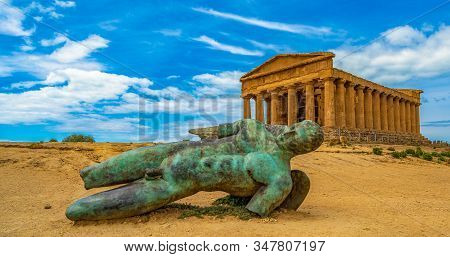Temple Of Concordia And The Statue Of Fallen Icarus, In The Valley Of The Temples, Agrigento, Sicily