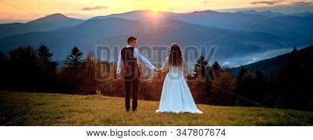 Bride And Groom At Sunset Romantic Married Couple