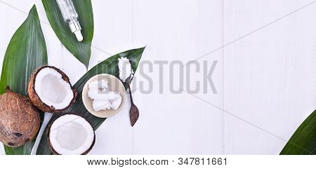 Broken Coconut And Butter. Exotic Fruit On A White Background. Free Space For Text. Copy Space. Flat