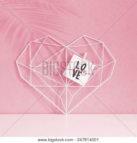 Elegant Openwork Heart On A Pastel Pink Background. Minimalism. Concept Symbol Of Love And Valentine