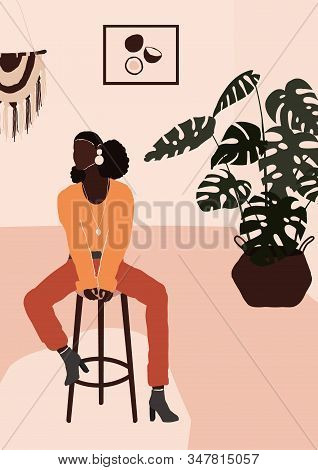 Abstract Modern African American Black Woman In Fashion Trendy Clothes Sitting On Chair In Room With