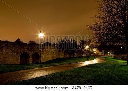 Street Lights By Town Wall In Almedalen, Visby, Sweden By Night.