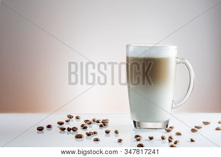 Cup Of Coffee Latte And Macchiato And Coffee Beans On White Background