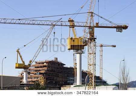 Construction Of A Ship In The Shipyard Of Vigo City With Cranes And Scaffolds.