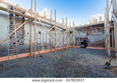 Process Of Solidification Of Concrete Floor Before Pouring And Reinforcement Of Load-bearing Walls W