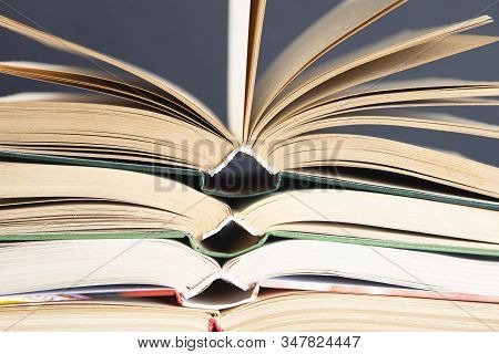 A Simple Composition Of Hardback Books, Raw Books. Open Books. Stacking Books Without Inscriptions,