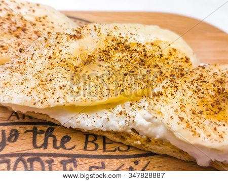 Breakfast Open Sandwich With Soft Cream Cheese Ricotta, Banana, Cinnamon On A Rustic Wooden Board. C