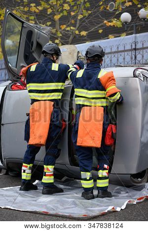 Rescue Intervention Team Trying To Save A Victim From A Car Accident