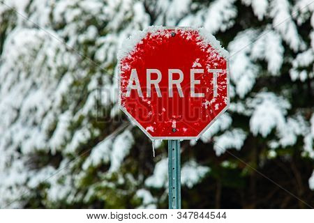Adverse Weather Conditions On Public Roads And Highways. A French Canadian Traffic Sign Saying Stop