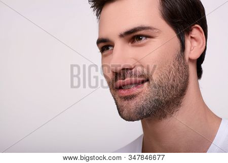 Close-up Man Portrait. Male Attractiveness Concept. Close Up Portrait Of A Sexy Smiling Young Man Wi