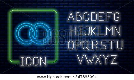 Glowing Neon Wedding Rings Icon Isolated On Brick Wall Background. Bride And Groom Jewelery Sign. Ma