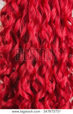 Hair Texture Closeup. Redhead Girl With Brilliance Long Wavy Wig. Natural Beauty. Young Girl With Pe