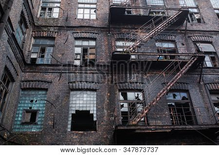 Old Abandoned Factory. Gothic Industrial Background. Scary Place. Post Apocalyptic Landscape. Hallow