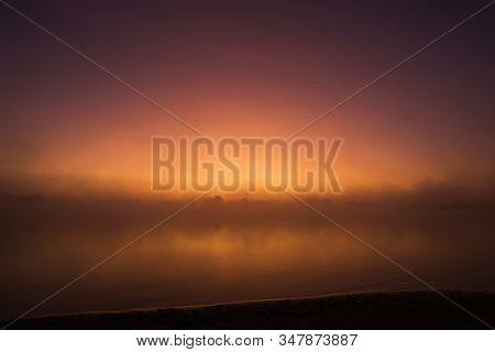 Mist Over River. Nature Background. Morning Sunrise. Beautiful Summer Foggy Landscape. Dusk Over Lak