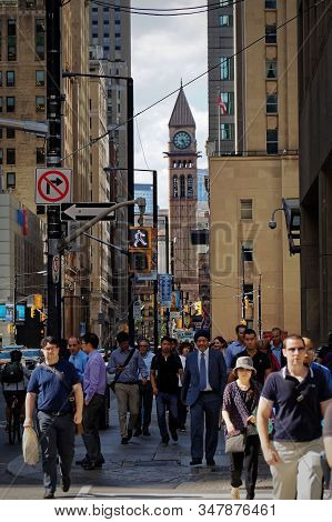 Toronto, Canada - 06 28 2016: People Approaching A Crosswalk On Bay Street In Downtown Toronto With
