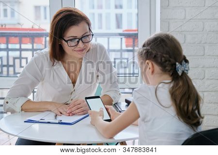 Girl At Meeting With Psychologist Showing His Social Page On Smartphone, Talking Psychiatrist And Ch