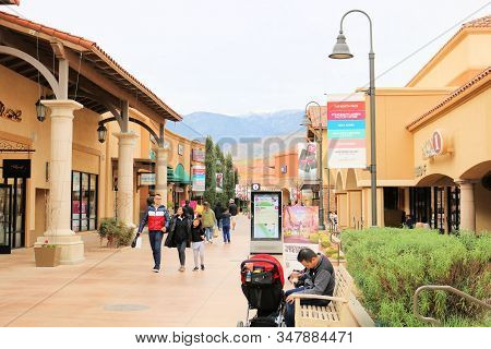 January 10, 2020 In Cabazon, Ca:  People Walking Besides Retail Outlet Stores Shopping For Bargains