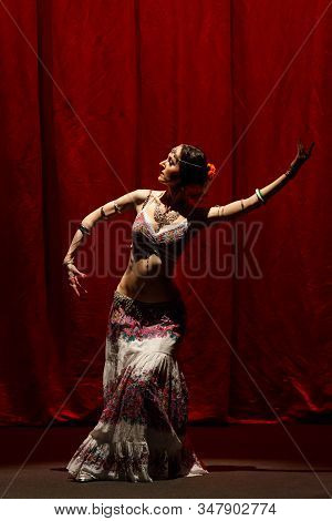 Dancer Dancing Belly Dance On A Concert Stage.