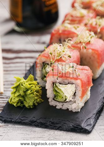 Traditional Japanese Sushi With Salmon, Ginger And Isabi On Black Stone Texture Board. Sushi Serving