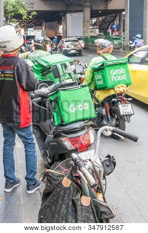 Bangkok, Thailand - January 9th 2020: Grab Food Motorcyclists On Sukhumvit Road. The Service Is Beco