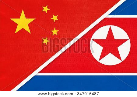 People's Republic Of China Or Prc Vs North Korea National Flag From Textile. Relationship Between Tw