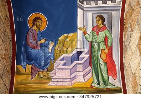 OHRID, MACEDONIA - MAY 04, 2019: Jesus and the Samaritan woman, fresco in the Church of Saint Paraskeva of the Balkans near Saint Naum Monastery, Ohrid in Macedonia