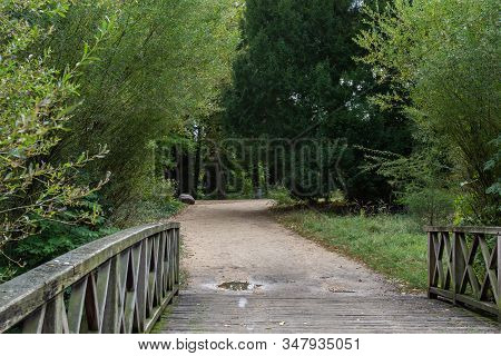 Walking In The Palace Garden Of Charlottenburg On An Autumn Day, Small Bridges Over The River , A Di