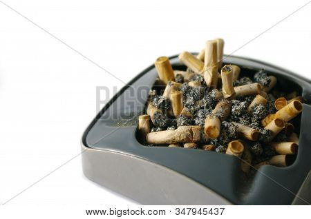 Ashtray Full Of Cigarette Butts, Isolated On White Background, Stop Smoking, Bad Habit. Warning Pict