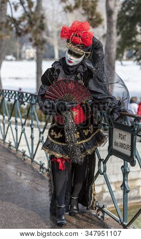Annecy, France, February 24, 2013:  Image Of A Disguised Person Posing On Pont Des Amours In Annecy,