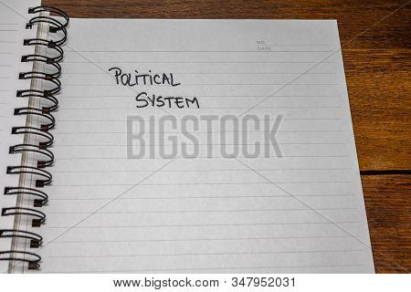 Political System, Handwriting  Text On Paper, Political Message. Political Text On Office Agenda. Co