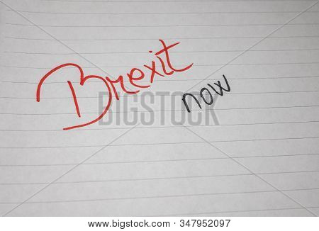 Brexit Now, Handwriting  Text On Paper, Political Message. Political Text On Office Agenda. Concept