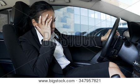 Business Woman In Suit Sitting In Auto, Feeling Sick And Tired, Pms Symptoms