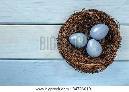 Happy Easter, The Religious Holiday Of Holy Easter. Wooden Background, Rustic Style. Egg Hunt.