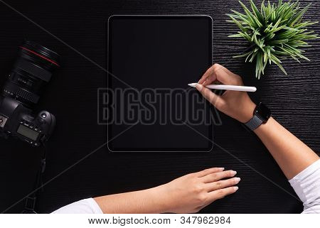Designer Using Stylus Pen On Top View