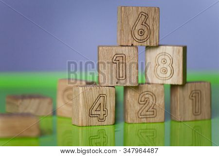 Arithmetic, Mathematic, Learning Concept, Numbers Background With Wooden Cubes. Shallow Depth Of Fie