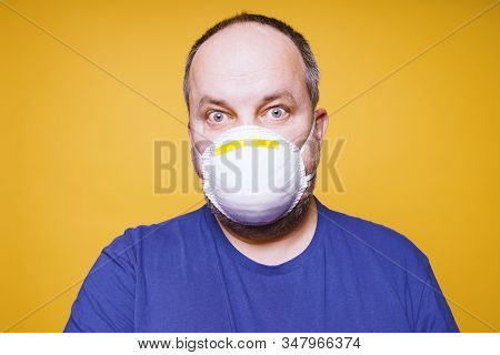 Man With Face Mask And Panic In His Eyes - Corona Virus Outbreak Hysteria Concept