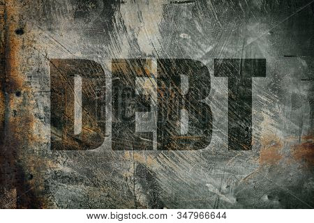 Debt written on steel background