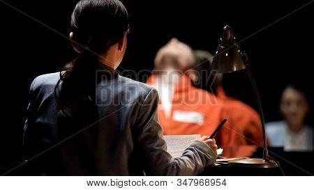 Female Prosecutor Interrogating Suspect In Criminal Case, Crime Investigation