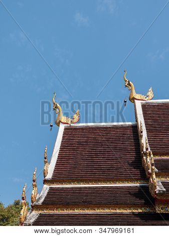 Golden Elephant Sculpture In The Traditional Thai Style On The Eaves Of The Church Roof In The Thai