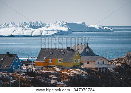 Aerial View Of Arctic City Of Ilulissat, Greenland. Colorful Houses In The Center Of The Town With I