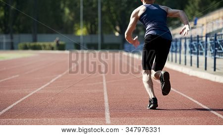 Male Athlete Starting To Run, Training His Body And Stamina, Active Way Of Life