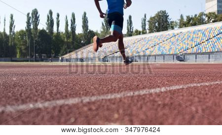 Athletic Guy Running At Stadium, Preparing For Competition, Daily Workouts