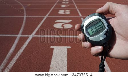 Male Hand Holding Stopwatch With Zero Time, New Life Stage Beginning Fresh Start