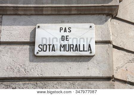Street Sign In Barcelona City, Spain. Pas De Sota Muralla.