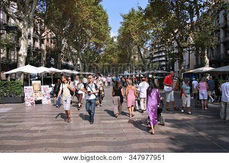 Barcelona, Spain - September 13, 2009: Tourists Visit Ramblas In Barcelona, Spain. Rambla Boulevard