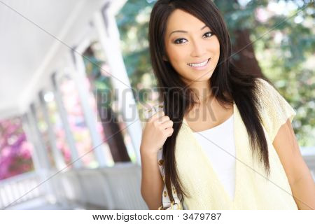 Pretty Asian  At Home On Porch
