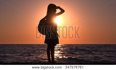 Kid On Beach Seashore At Sunset, Child Playing On Coastline, Teenager Girl Watching Sea Waves At Sea