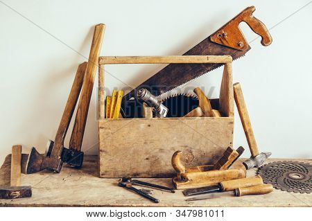 Old Wooden Tool Box Full Of Tools. Old Carpentry Tools. Carpenter Table. Woodwork. Copy, Empty Space