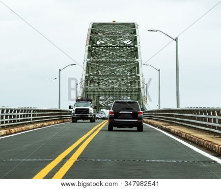 Cars Traveling On The Robert Moses Bridge Going To And From The Fire Island National Sea Shore Beach